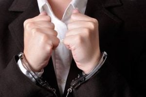 Albuquerque white collar crime attorneys - man in handcuffs